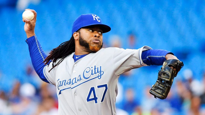 Kansas City Royals starting pitcher Johnny Cueto works against the Toronto Blue Jays during the first inning of a baseball game, Friday, July 31, 2015 in Toronto. (Nathan Denette/The Canadian Press via AP) MANDATORY CREDIT